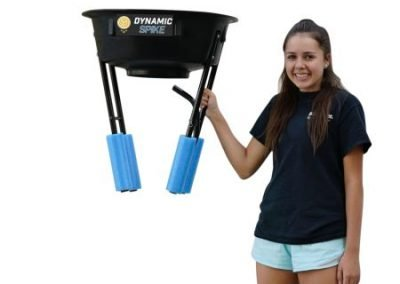 Girl holds the lightweight yet rugged DynamicSpike Volleyball Hitting Trainer, which is a useful piece of volleyball training equipment