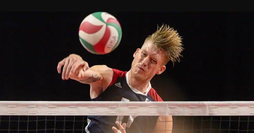 Man spiking a volleyball
