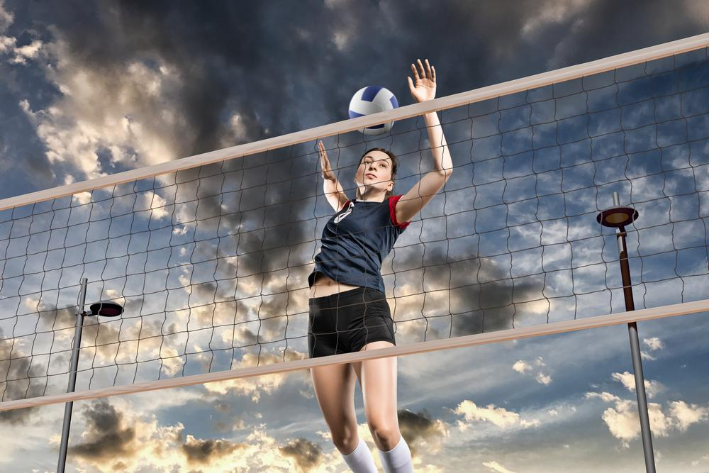 Woman readies to spike a volleyball