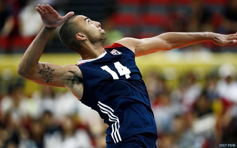 Man serves a volleyball