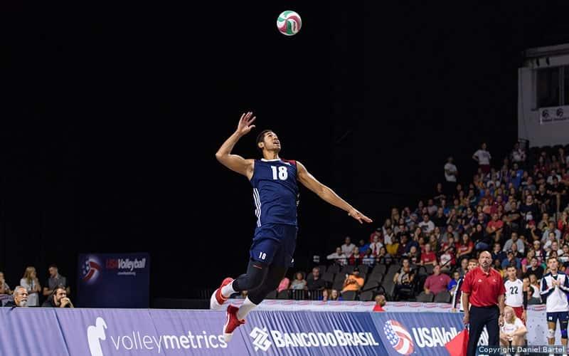 Player jump serves a volleyball