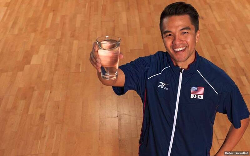 Volleyball player holding a big glass of water