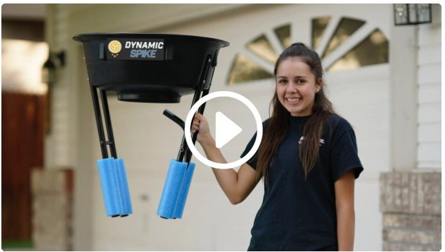 Girl holds the lightweight DynamicSpike Volleyball Hitting Trainer