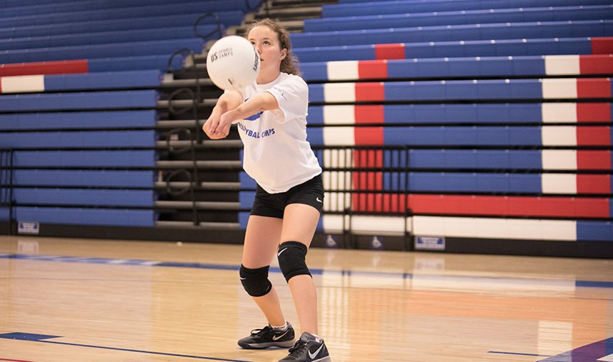 Female volleyball player passes the volleyball
