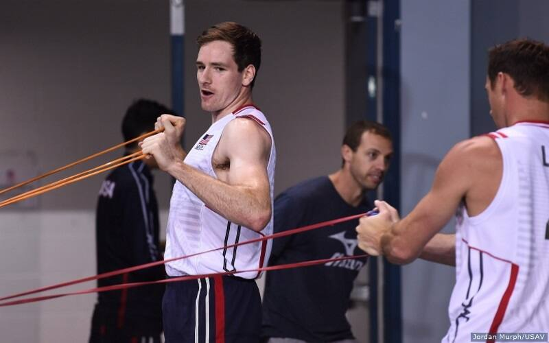 Male volleyball player works with fitness bands