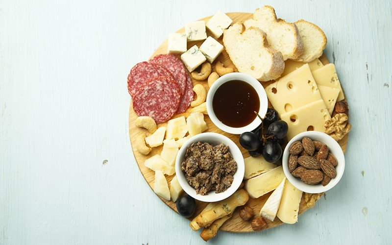 Plate of cheese, salami, crackers, etc.